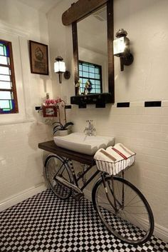 Looking at this charming bathroom with a creative twist, a bicycle sink. Would you ever use a bike and transform it into a bicycle sink in your bathroom? I think the black & white tile floor and b Style At Home, Cali Style, Bicycle Sink, Bicycle Decor, Bicycle Basket, Bicycle Wheel, Tandem Bicycle, Cruiser Bicycle, Diy Casa