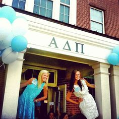 ADPi greeting their new members on Bid Day