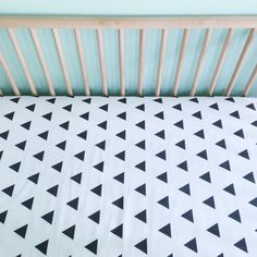 Black and White Triangles Crib Sheet from @iviebaby - love this look in a modern black and white nursery!