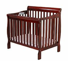 Again, converts to a twin!  And the price, with high rating - can't be beat.  Right now I think this tops my list...now all I need is a baby!  Amazon.com: Dream On Me 4 in 1 Aden Convertible Mini Crib, Cherry: Baby