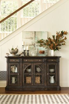 Handsomely crafted of pecan solids and veneers, the Chapleau Sideboard is a classically elegant piece that will enrich any space with its antique-style allure.