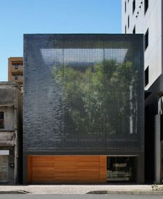 A tree-filled courtyard is behind a shimmering glass-brick facade at the Optical Glass House in Hiroshima by Hiroshi Nakamura & NAP. Architecture Design, Facade Design, Residential Architecture, Contemporary Architecture, Exterior Design, Minimalist Architecture, Building Architecture, Installation Architecture, Ancient Architecture