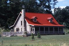 "The custom standing-seam red-steel roof adds farmhouse appeal to the home. ""We chose this roof for the look and relaxing sound that a metal roof makes in the rain,"" says Hugh. The couple chose to screen in the front and back porches to enjoy the magnificent views and beautiful landscape while keeping insects at bay."