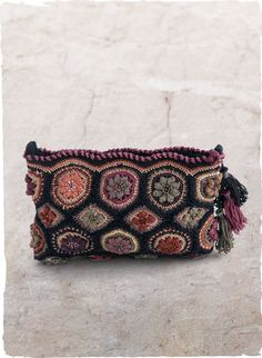 Meticulously handcrocheted of pure pima, our clutch is embellished in a tilework of dimensional beaded blooms and finished with a scalloped zip top and tassel trim.