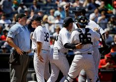 June 7, 2015 -- Tempers Are Hot, but So Are the Yankees - C.C. Sabathia was held back as Manager Joe Girardi had some words for the umpire Dan Bellino. New York Yankees 6-2 win over the Los Angeles Angels at Yankee Stadium on Sunday, Yankees players posed for pictures, many of them selfies, with season-ticket-holding fans.Credit Seth Wenig/Associated Press NYTimes.com