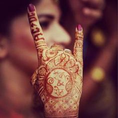 Red mehndi design with letter