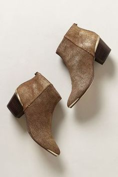 Perfect ankle booties. Love the metallic accents!