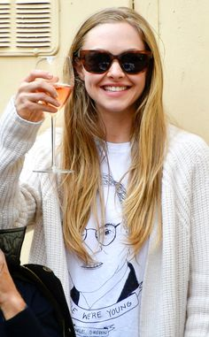 Wine makes everything better! Just check out Amanda Seyfried, in chic tortoise sunnies, enjoying a glass of vino in Rome!