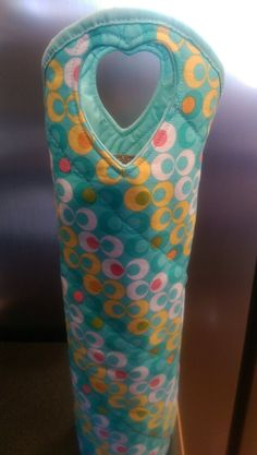 Check out this item in my Etsy shop https://www.etsy.com/listing/226359616/wine-tote-in-blue-pink-yellow-and-white