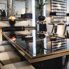 Contemporary Ebony Gold Leaf Dining Table at Juliettes Interiors.