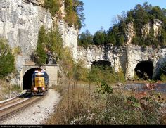 An SD60 on the point at Tunnel 18, on the former L&N, now CSX CC Sub. A couple old mine shafts are to the right near the line.