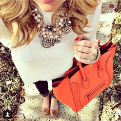 Statement necklace, pale sweater, orange Celine bag, nude tory burch flats and rolled up jeans. #daily #perfection