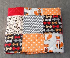 We like a lot of the patterns used in this quilt. (Bowties, glasses, hounds tooth, foxes)  Fox & The Houndstooth Quilt, using fabrics from Robert Kaufmans line of the same name.  Have an upcoming baby shower? This quilt is finished and