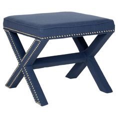 Create additional seating in your living room or study with this navy footstool. Featuring a nailhead trim, it is sure to catch the eye of every guest. ...