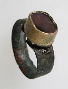Finger Ring Date: century Geography: Made in Northern France Culture: Frankish Medium: Silver, gold bezel, glass paste or carnelian(? x 2 x 1 cm) bezel: x x in. Ethnic Jewelry, Jewelry Art, Jewelry Design, Jewlery, Antique Rings, Antique Jewelry, Vintage Jewelry, Medieval Jewelry, Ancient Jewelry
