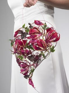 For the bride or the bridesmaids - contemporary floral bouquets. Kind of pretty. Would want handle on back instead of top.