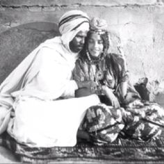 Ouled Nail Tunisian Berber couple c.1904. I love everything about this picture! Look carefully, she's smoking.