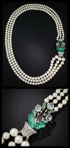 Glorious Art Deco pearl necklace by Boucheron ~ circa 1920s. Just look at that clasp! Floral motif with carved emeralds and rose-cut diamonds.