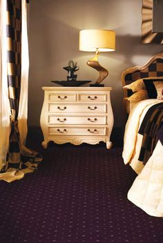 The Prince Bishop is a patterned eight row Axminster carpet with a classic pattern design in the form of a Sceptre, Crown and Trellis, available in 20 colours, with 60 different choices in one carpet range. This carpet is suitable for heavy domestic use around the home, excluding kitchens and bathrooms. It also carries with a 7-year Wear Warranty.