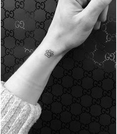 Initial paw print tattoo