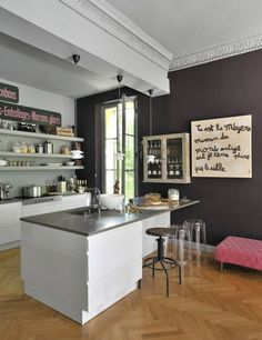 Nice kitchen with grey worktop and a bar area