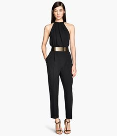 Sleeveless jumpsuit in woven fabric. Halterneck bodice with pleats and ties at neckline and V-neck at back. Pant section in thicker fabric with a slightly dropped gusset, tapered legs, and side pockets | H&M US