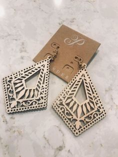 Plunder Design offers chic, stylish jewelry for the everyday woman. Wooden Earrings, Wooden Jewelry, Diy Earrings, Resin Jewelry, Jewelry Crafts, Earring Crafts, Laser Art, Laser Cut Wood, Laser Cutting
