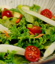 A salad that combines fresh ingredients with wasabi edamame dressing.