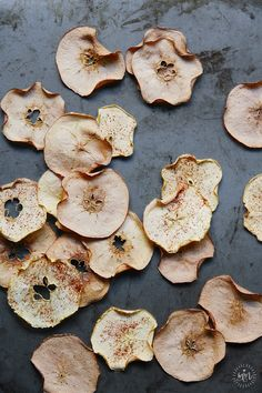 The easiest baked apple chips! Just 1 ingredient (or two, if you want the cinnamon sprinkled version). Thin, crisp, sugar-free and no dehydrator required. #healthy #healthysnack #healthykids #sugarfree #glutenfree #missmarzipan
