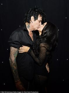 Pucker up! Former Mötley Crüe drummer Tommy Lee shared an awkward smooch with his much younger girlfriend Brittany Furlan at the Streamy Awards in Beverly Hills on Tuesday