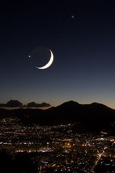 Crescent moon and Venus over Palermo, Italy