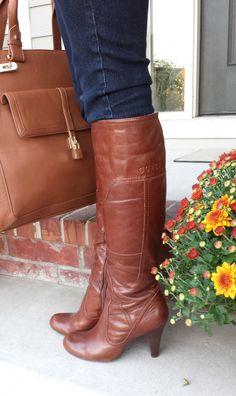 I WISH I could wear the boots, but the heels would KILL my back. I LOVE the purse in the picture also, again I'd want one in brown and black!!