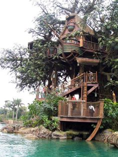 This is the Swiss Family Robinson Treehouse, a Disneyland attraction. I have added more pixs of the house.   One of our number one picks is this gorgeous and very sophisticated looking tree house, set on the very top of the tree, from where you can see if the pirates are coming and in what numbers. It also has a boat with a pulley so that on case of siege, you can flee away. This is truly a fairy tale tree house!