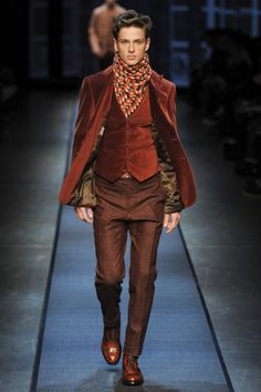 Double breasted jackets, plush velvet, and rich earth tones: The Canali Fall 2013 collection is classic Victorian for the modern gentleman....