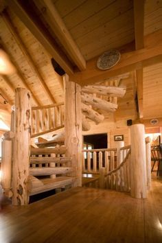 Custom half log spiral staircase with hand scraped wood railing to loft from great room, and mirrored log spiral staircase to basement. Log Cabin Living, Log Cabin Homes, Log Cabins, Mountain Cabins, Spiral Staircase Plan, Staircase Ideas, Spiral Staircases, Double Farmhouse Sink, Wood Railing