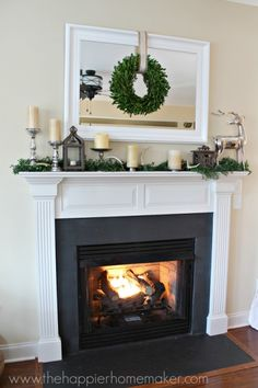 Holiday decorating doesn't have to cost a lot of money. Use these inexpensive Christmas Decorating Ideas to help you make your home look festive on a budget! Mirror Over Fireplace, Fireplace Mantle, Wreath Over Mirror, Mantle Mirror, Fireplace Decorations, Black Fireplace, Farmhouse Fireplace, Fireplace Surrounds, Small Space Interior Design