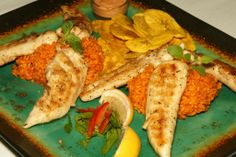 Make a complete meal the adobo way, with Abraham Rosa Seasonings! Here is a fine example of an entree made with our all-natural, all-purpose seasoning. The fish fillets were rubbed in it, the rice was mixed with it, and the plantain chips have a dip to use that's made with our seasonings. It is a perfect example of how versatile our seasoning can be with many savory or bland-tasting foods.  Buy some NOW, at http://abrahamrosaseasonings.com/ !