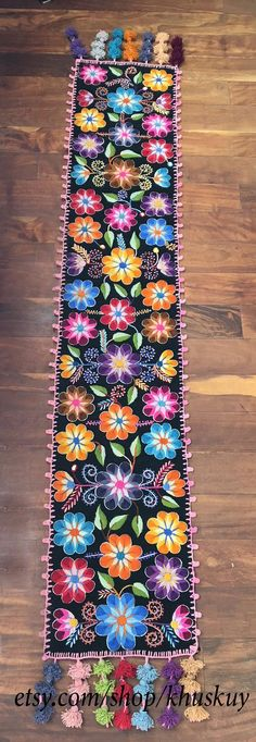 Peruvian Embroidered Table Runner Sheep wool runner hand embroidered with graceful flowers and leafs, finished with multicolored tassels. Each runner is a work of art. It takes several days to finish every unique piece, from the weaving of the fabric, the embroidery to the last hand made