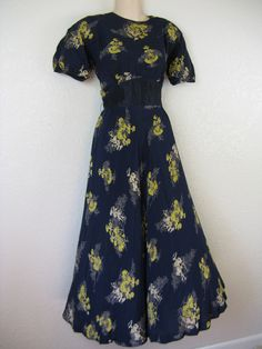 Navy 1940's rayon dress with ladies. $85.00, via Etsy.