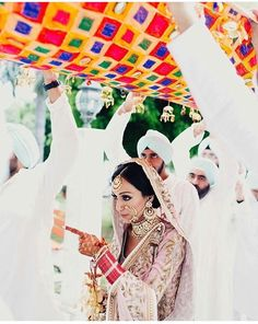 Punjabi wedding tradition. Holding chadar over head. East and west punjab. Punjab region.