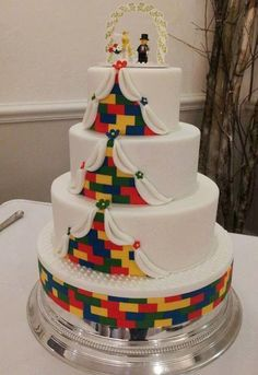 3 tier Lego wedding cake – the groom is a massive Lego enthusiast so the couple wanted a Lego themed cake! The base was custom made by sticking 5 boards together and covering in lego bricks! Lego Wedding Cakes, Unique Wedding Cakes, Beautiful Wedding Cakes, Wedding Cake Toppers, Cake Wedding, Wedding Ceremony, Wedding Venues, Dream Wedding, Lego Cake