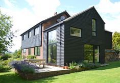 Beautiful black cladded home, West Sussex by ArchitectureLIVE - on Homify