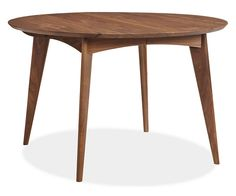 "Ventura Extension Tables - Tables - Dining - Room & Board $1,999 Dimensions:  48 round 29h Extensions:  two 18"" leaves; extends to 84w Table Seats:  four closed; six with extension Apron to Floor:  25h Space between legs:  23"""