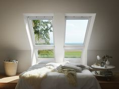 Sterlingbuild Tip! Use white top hung roof windows in loft bedrooms for a brighter finish. See how the light bounces off the white paint? The top hung design gives you more headspace to enjoy the views.