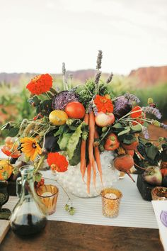Unique fall wedding centerpiece idea - zinnias, black-eyed Susans, wildflowers, carrots, tomatoes, onions, radishes, and eggplant {Gideon Photography}
