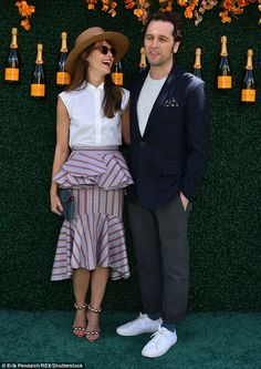 Summer loving: Keri Russell glowed in a summery peplum dress and white top as she attended...
