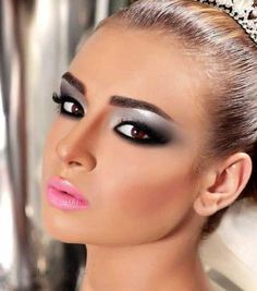 silver and black eye with a pink lip