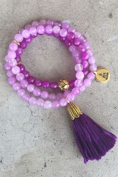 """Our new triple wrap bracelet is handmade of beautiful, purple faceted agate beads and finished off with a hand-cut, deep purple tassel. Strung on elastic cord to comfortably fit most wrists (sized to fit up to approximately a 7 1/2"""" wrist) Triple wrap style Gold-tone lotus flower guru bead Gold-tone buddha charm Gold-tone tassel cap with beautiful, deep purple colored, hand-cut cotton tassel Can also be worn as a necklace Made in our San Francisco, California workshop"""