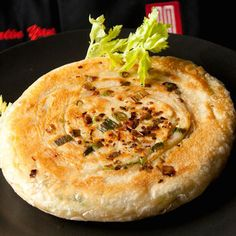 Cong You Bing (Scallion Pancakes) Recipe - Scallion pancakes are as widely popular in China as muffins are in America. The basic recipe for a simple scallion pancake—served with soy milk or rice porridge for breakfast—is just a guide. Some like it firmer, some fluffier.- Saveur.com