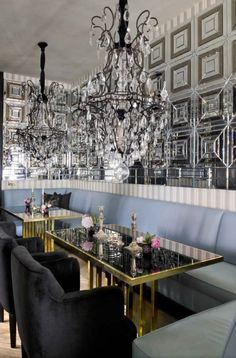 shockingly done for private res....wow factor of glass and chandeliers by lorenzo castillo dining room